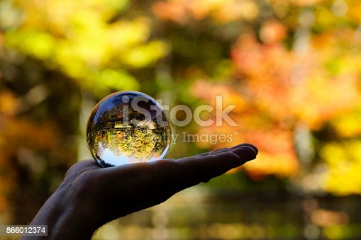 istock Crystal ball, beautiful Canadian autumn forest background 866012374