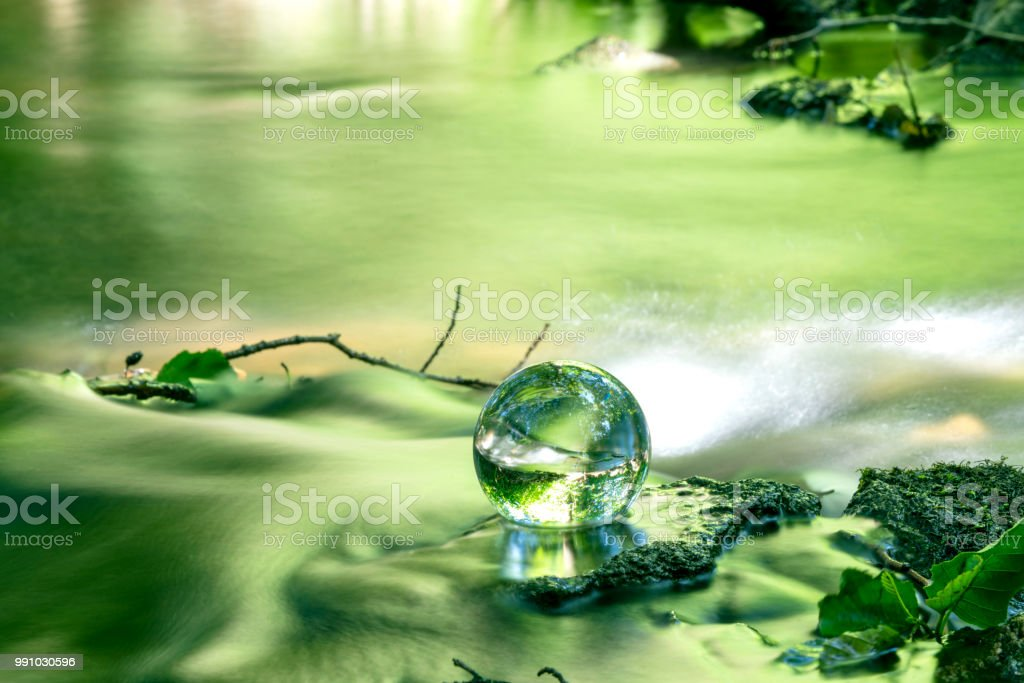 Crystal ball in a river in the spring stock photo