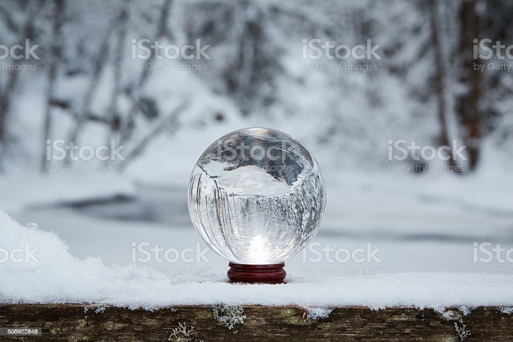 Crystal ball in the winter stock photo