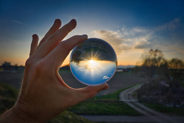 crystal ball - landscape and sunset - transparent stock photos and pictures