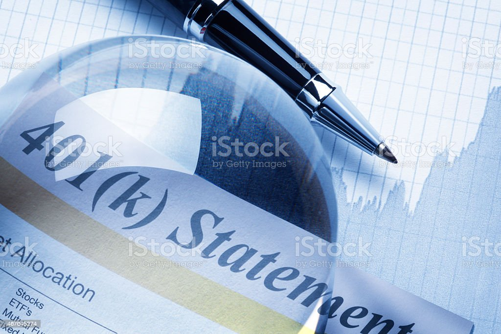 Crystal ball on a 401k statement stock photo