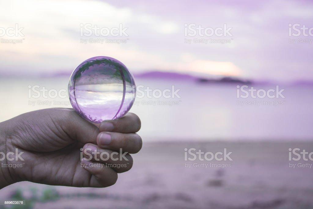 crystal ball on beach. stock photo
