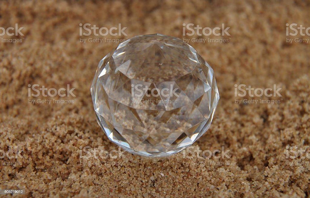 Crystal ball on sand stock photo