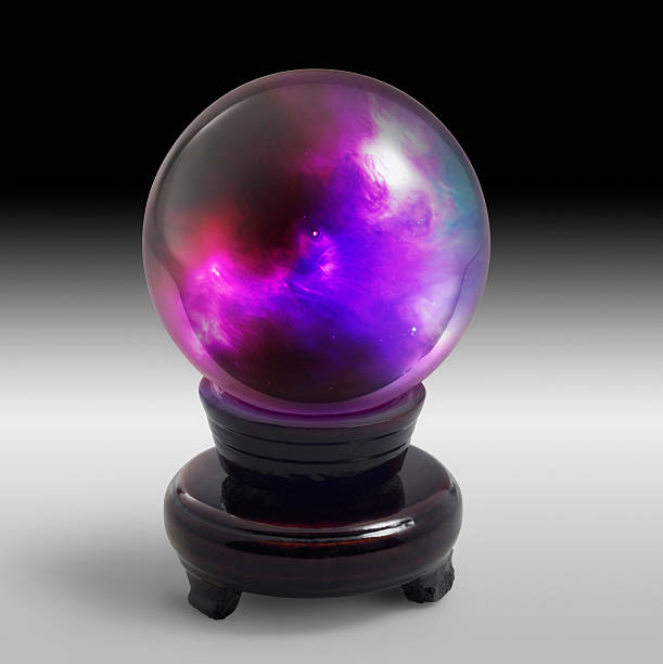 crystal ball on stand in light back stock photo