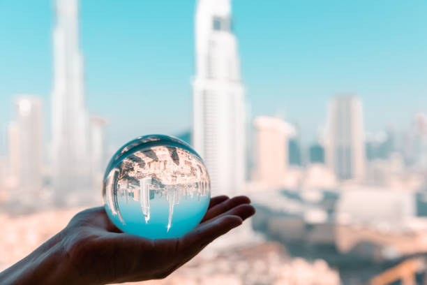 Crystal Ball with Reflection of Dubai CBD Skyline stock photo