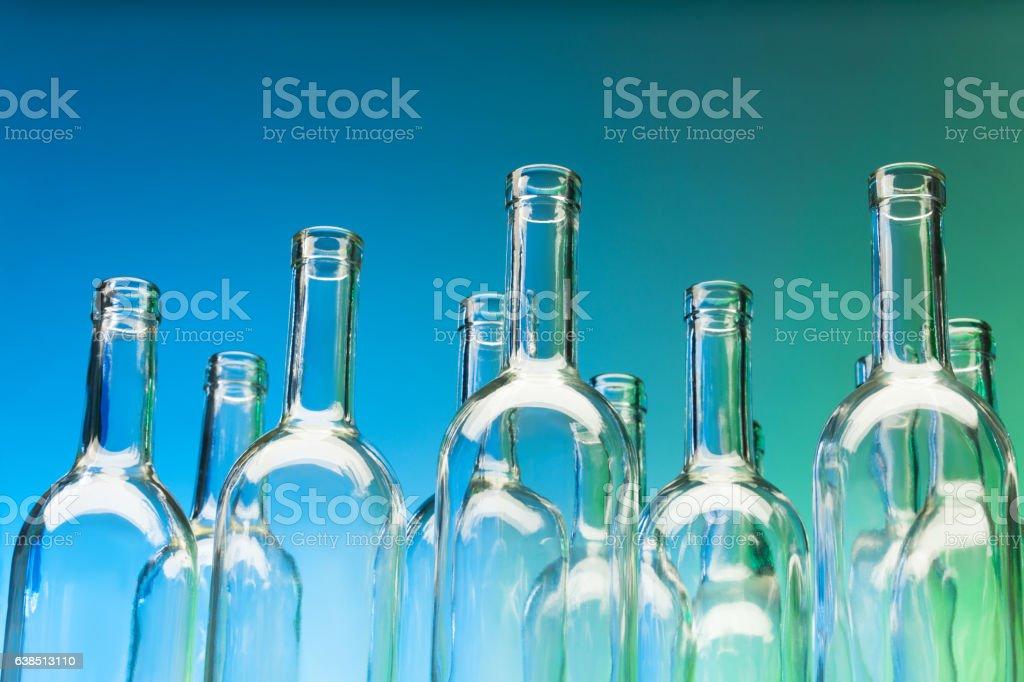 Crystal bottlenecks of empty glass bottles stock photo