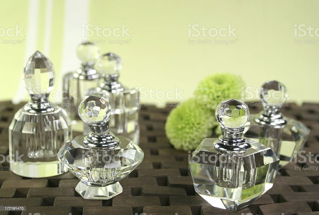crystal bottles & flowers - Royalty-free Alternative Medicine Stock Photo