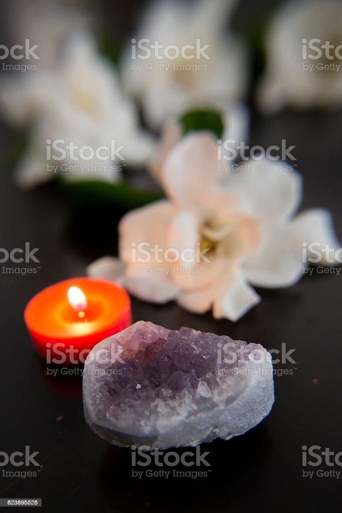 Crystal, candle, gardenia flower stock photo