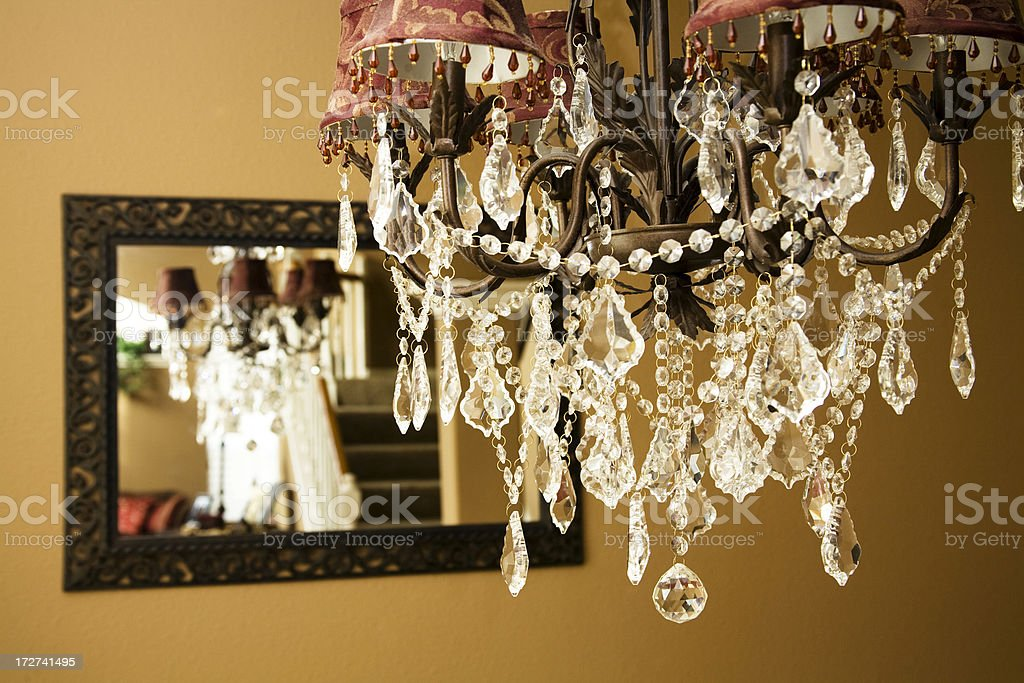 Crystal chandelier. Dining room. Reflection in mirror. Luxury, elegance. royalty-free stock photo