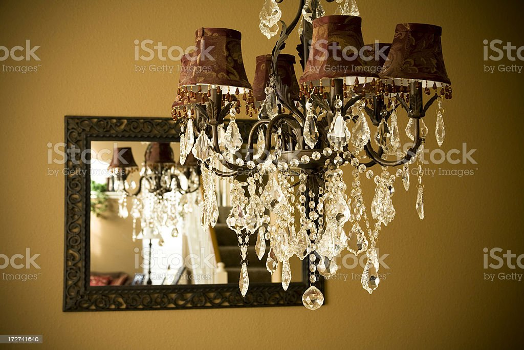 Crystal chandelier light fixture in dining room. Elegant, ornate, upscale. royalty-free stock photo