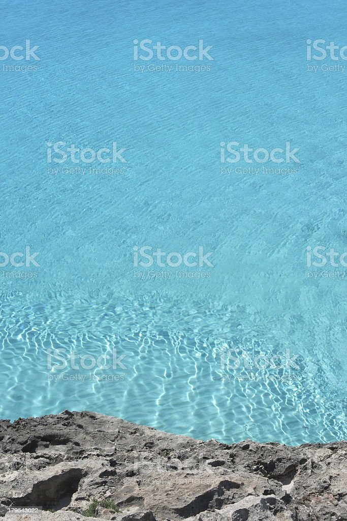 Crystal clear and turquoise sea in Mediterranean bay royalty-free stock photo