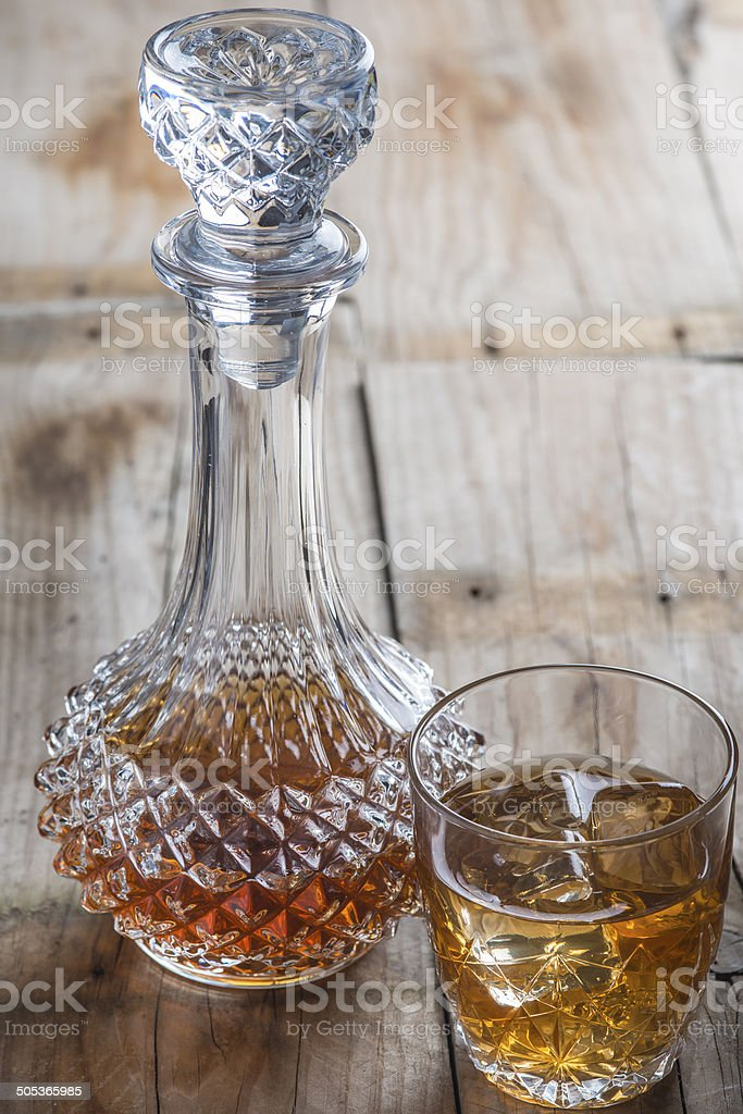Crystal clear luxury glass bottle with liquor stock photo