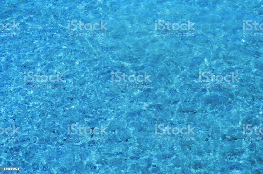 Crystal Clear Sea Water Ripples Sparkling In The Noon Sun