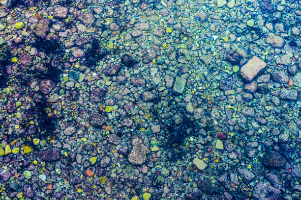 Crystal clear sea with rocks as abstract background stock photo