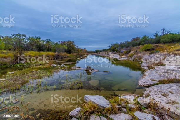Photo of Crystal Clear Stream Flowing Through the Wild Western Texas Hill Country