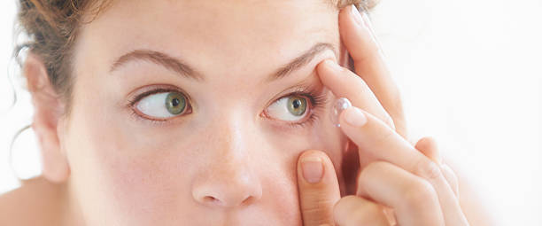 Crystal clear vision thanks to my contact lense Shot of a young woman putting on contact lenseshttp://195.154.178.81/DATA/i_collage/pu/shoots/805736.jpg lens eye stock pictures, royalty-free photos & images