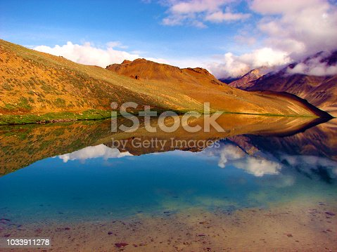 Clear water with reflection of dry mountains is a view to behold on 3 days adventure trek from Manali to Chandratal lake in Spiti valley, Manali, India