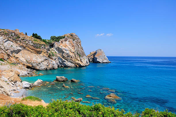 Crystal clear waters of Kastro beach, Skiathos, Greece stock photo