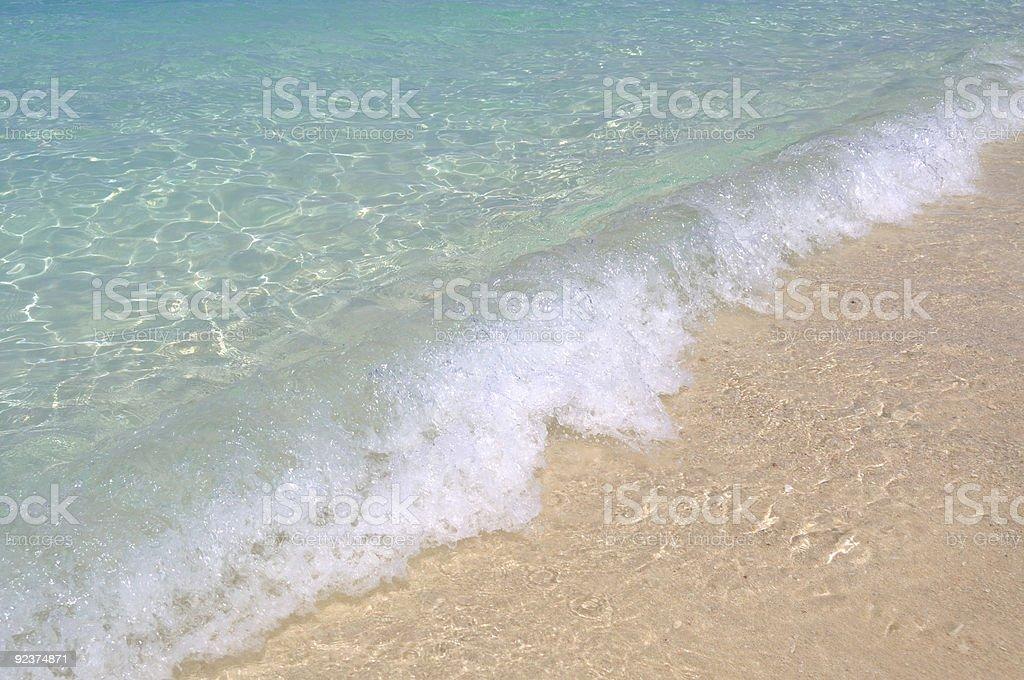 Crystal Clear Wave on Sandy Beach royalty-free stock photo