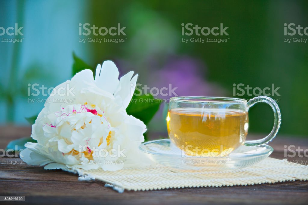 Crystal cup with green tea on table stock photo