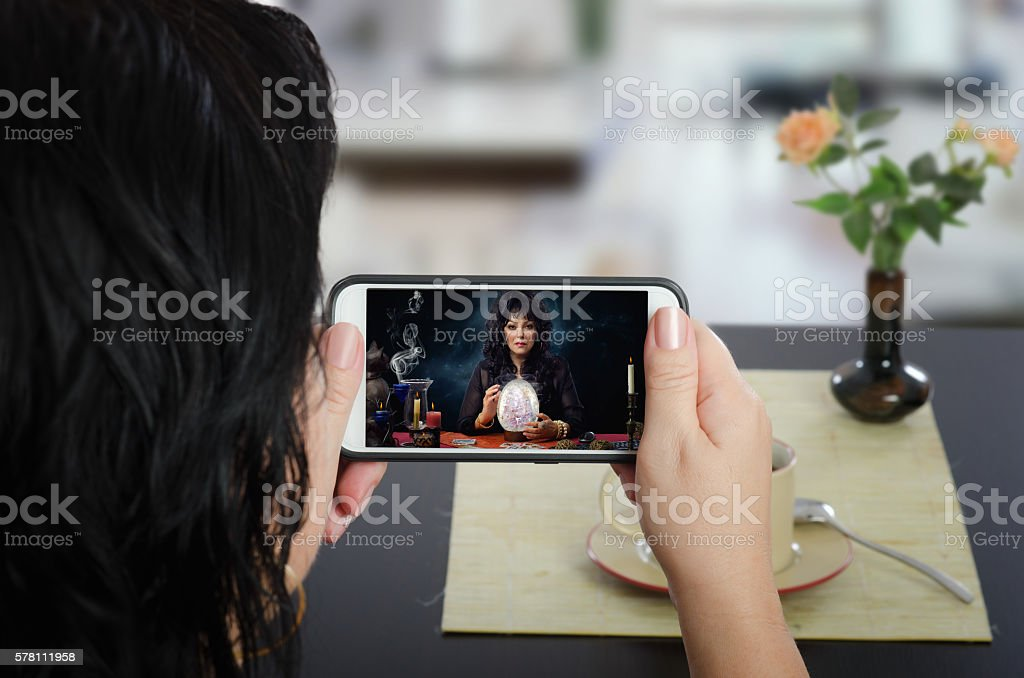 Crystal egg scrying online by mobile phone stock photo