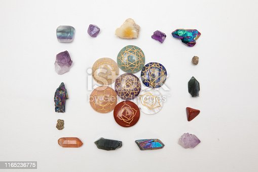 182911283 istock photo Crystal Frame with Chakra stones 1165236775