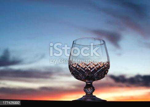873264516istockphoto Crystal Glass against Sunset 177425002