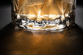 Crystal glasses of whisky on black table