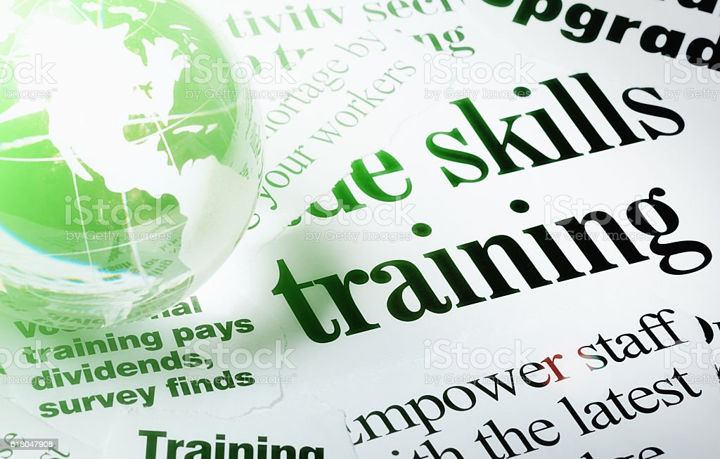 Crystal globe on headlines about the value of skills training stock photo