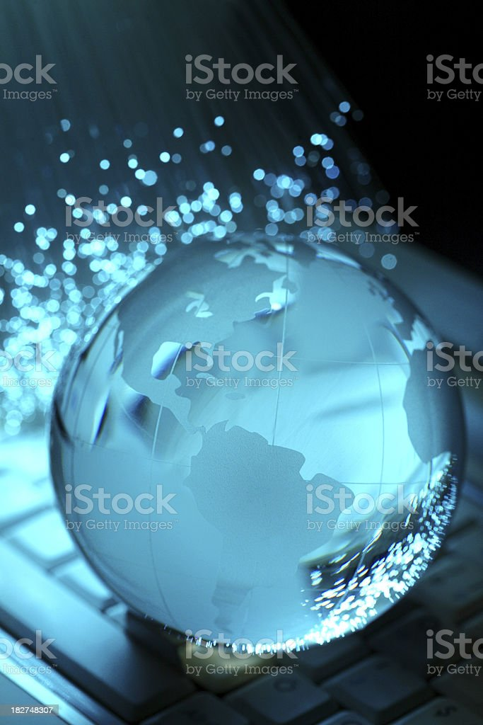 Crystal globe on keyboard and fiber royalty-free stock photo