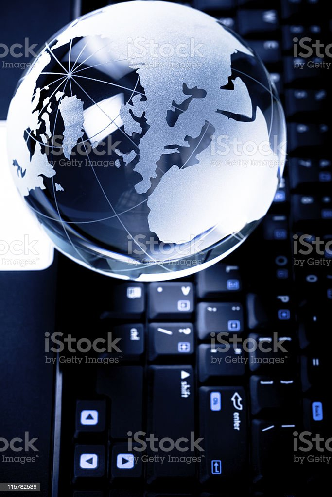 Crystal globe on keyboard royalty-free stock photo