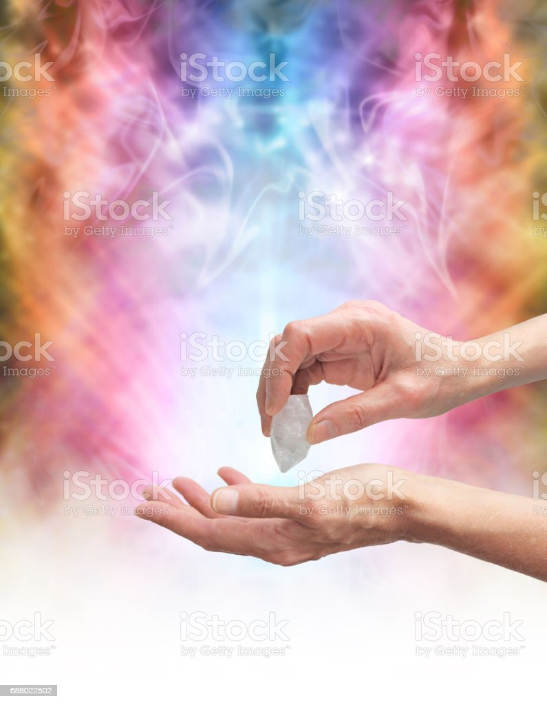 Crystal healer sensing energy with terminated quartz stock photo