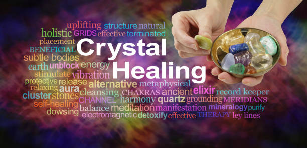 Crystal healing word cloud Female crystal therapist offering yellow stone from a selection of crystals in a brass dish, surrounded by a relevant word cloud on a vibrant multicolored background crystal healing stock pictures, royalty-free photos & images