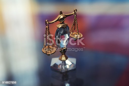istock Crystal justice scales 916607656