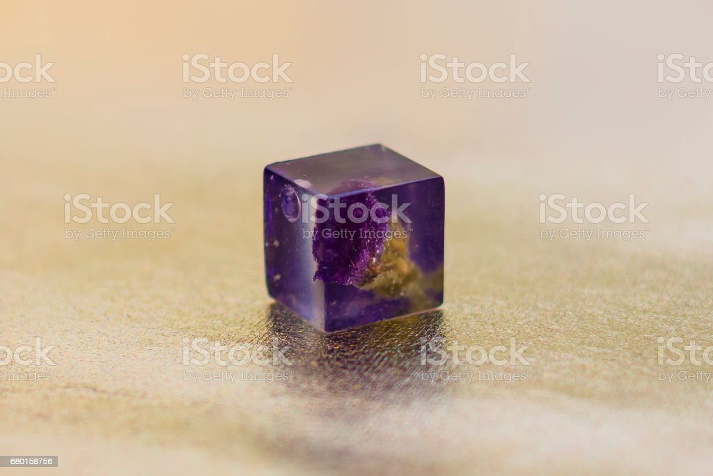 Crystal made of epoxy resin with flower stock photo