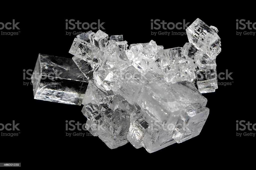 Crystal of mineral salt on a white background stock photo