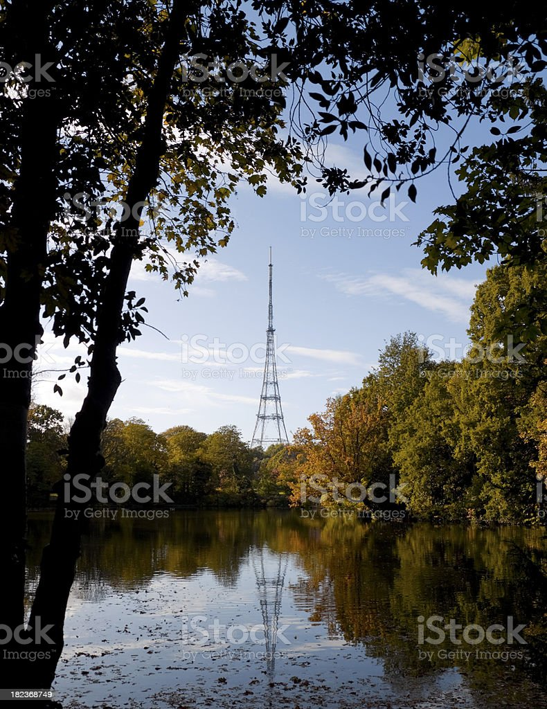 Crystal Palace mast reflected in a lake - autumn scene stock photo