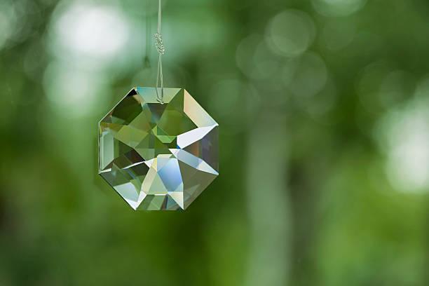 Crystal prism on defocused green background stock photo