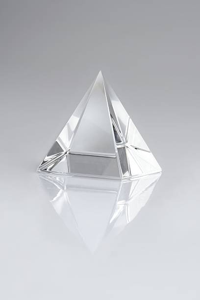 crystal pyramid - crystal glassware stock photos and pictures