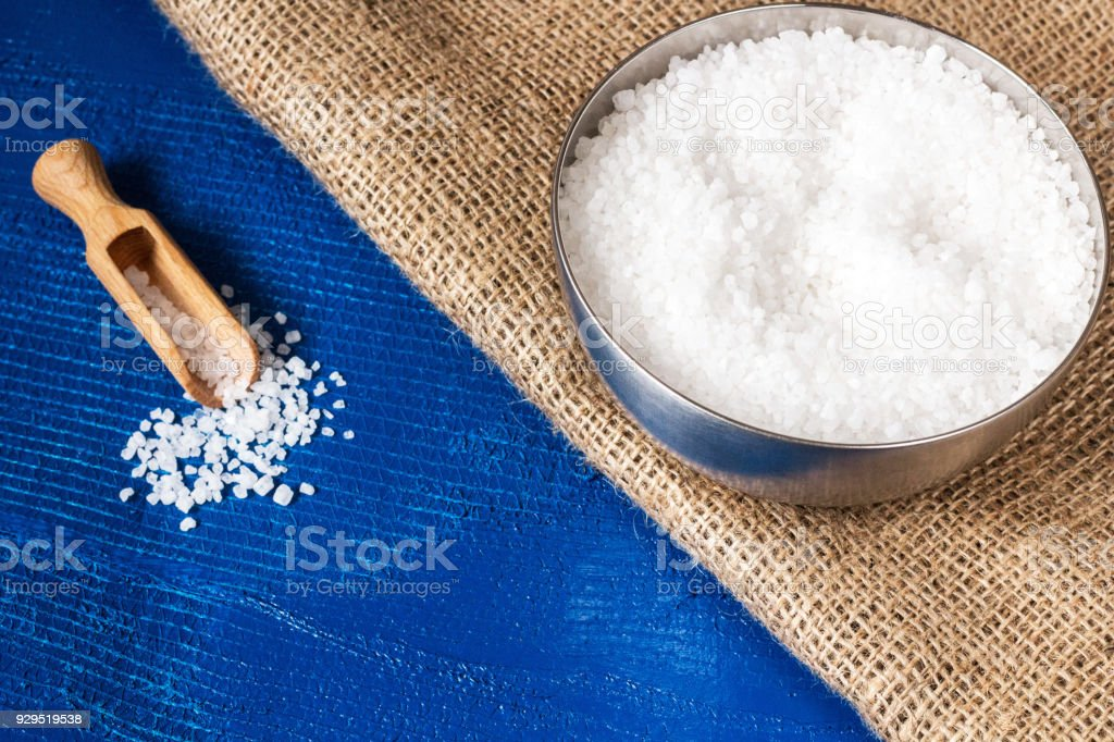 crystal salt in metal bowl. food concept background