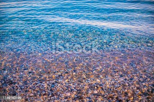 Pebble stones in beautiful sea water