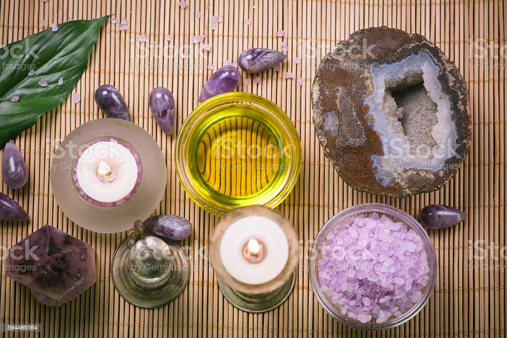 Spa therapy with crystal and sea salt background.