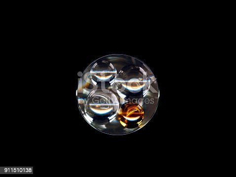 istock Crystal sphere balls inside a water cup in an isolated background 911510138