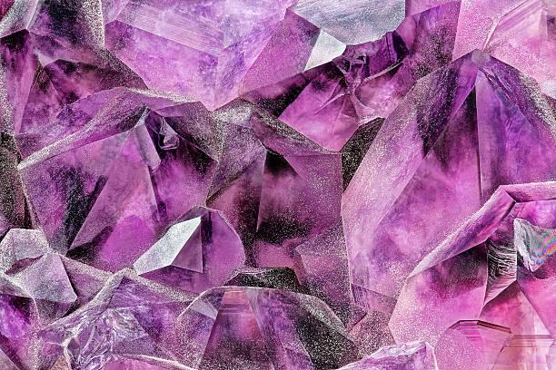 Crystal Stone macro mineral surface, purple rough amethyst quartz crystals stock photo