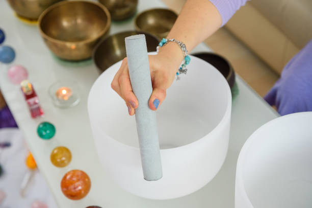 crystal therapy with bowls - crystal stock pictures, royalty-free photos & images