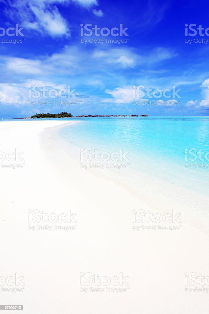 Crystal transparent sea and blue sky with white clouds. royalty-free stock photo