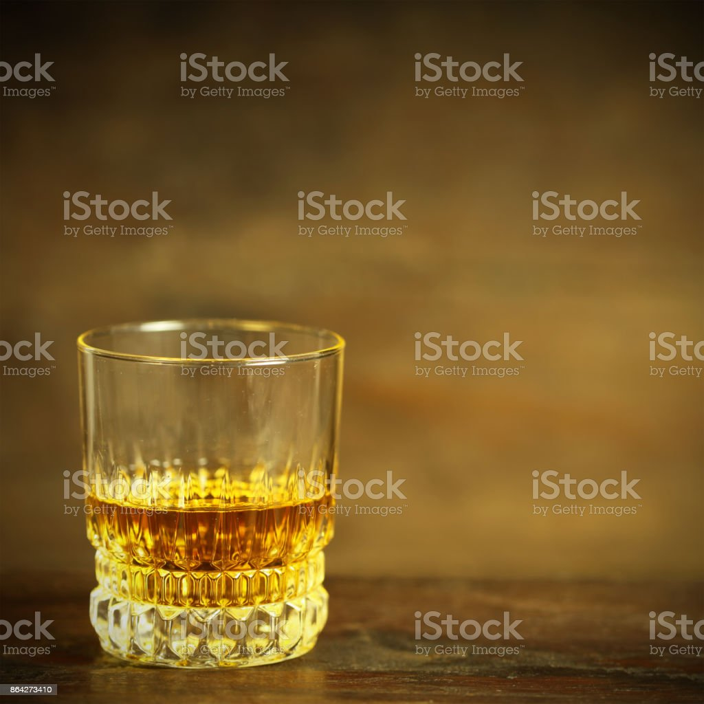 Crystal Whiskey Glass on Rustic Background royalty-free stock photo