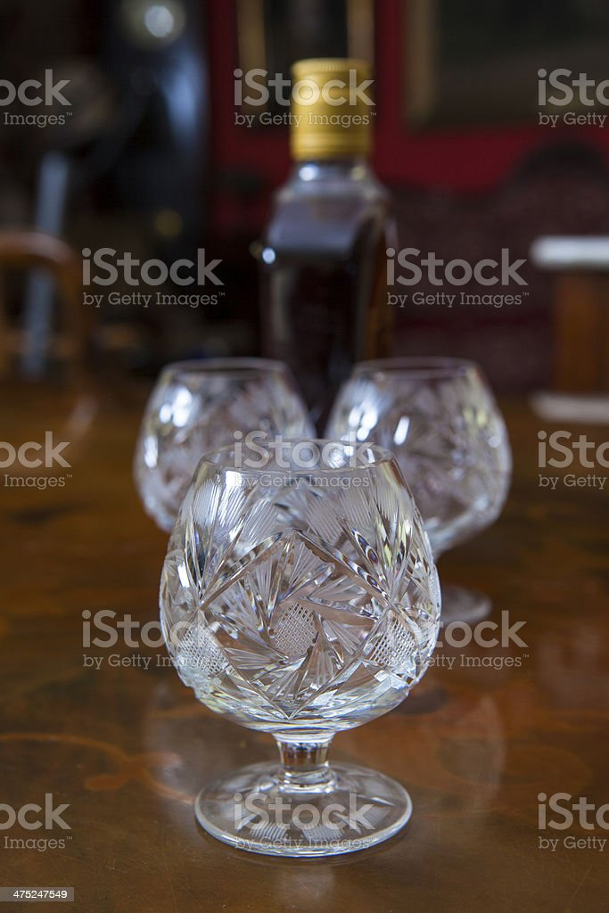 Crystal wine glasses and a bottle of brandy royalty-free stock photo