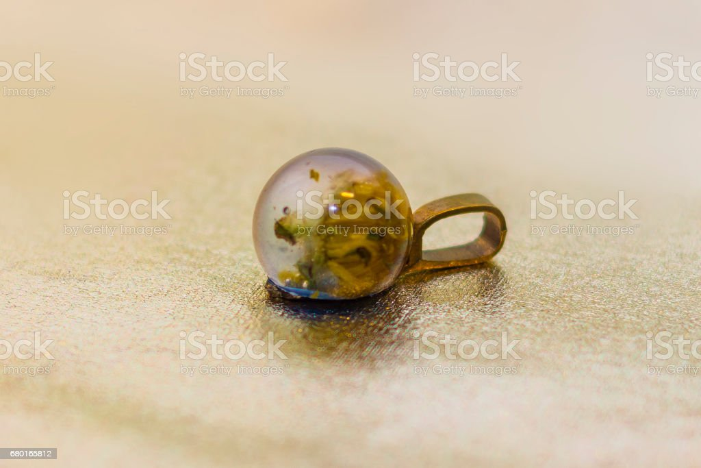 Crystal with flower made of epoxy resin close-up stock photo