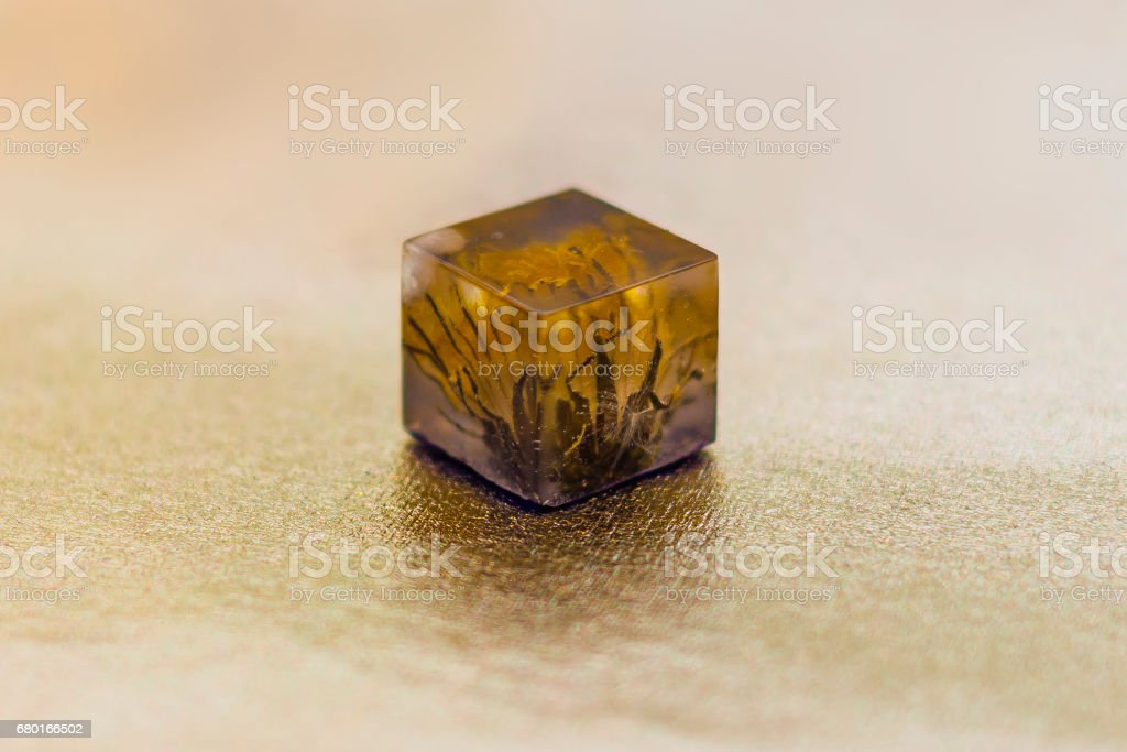 Crystal with flower made of epoxy resin stock photo